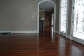 gorgeous dark wood flooring combined with solid wall painted in grey and white wooden windows