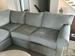 ethan allen slipcovered sofas gray sectional with round coffee table plus brown rug also ceiling lighting for furniture modern living room