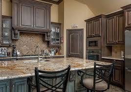 rich dark wood cabinet kitchen with distressed wood island