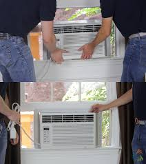 window air conditioner installation. step 4: lift air conditioner into window installation