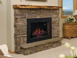 33ii310gra classic flame electric fireplace with bbkit33 trim surround kit installed in a stone fireplace