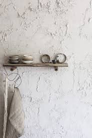 in the atelier st george showroom in vancouver the walls are intentionally crumbling