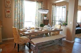 pretty dining room set with bench and modern pendant lamp with wood laminate floor