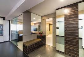 Small Picture Glass mirrors and glossy laminates amp up the posh factor in