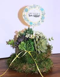 unique moss covered teacup planter idea for succulents