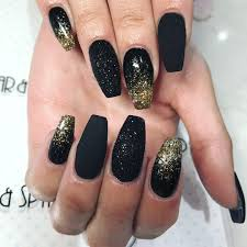 cute black and gold glitter nails