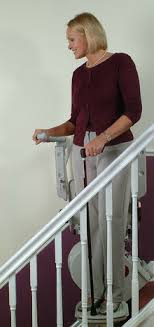 standing stair lift. Woman Traveling Downstairs On A Stand Stairlift Standing Stair Lift S