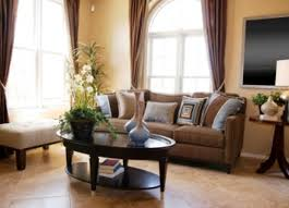 living room mocha fabric sofa and dark brown wooden table on beige tile floor with