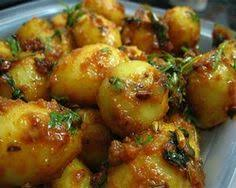 how to make dum aloo dum aloo is a por kashmiri recipe and made all over india baby potatoes are fried and cooked in a gravy
