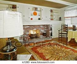 1960s interior of living room with area rug fireplace and early american home decor and furniture