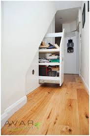Plentiful White Wooden Hidden Storage Under Stairs With Built In Cabinetry  Shelves As Space Saving Furnishings Ideas