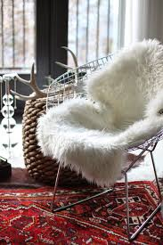 faux sheep skin on vintage wire chair in bedroom sheepskin rug fur throw