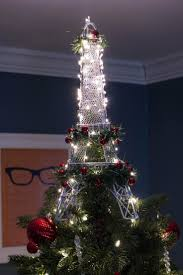 ... Large Eiffel Tower tree topper lit up with lights
