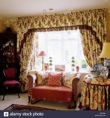 Patterned Curtains For Living Room Small Sofa In Front Of Window With Floral Patterned Curtains And