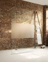 a large fixed frameless glass shower screen including modesty panel in a luxurious wetroom