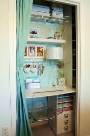 home office in closet. love the added lamp in this organized home office closet