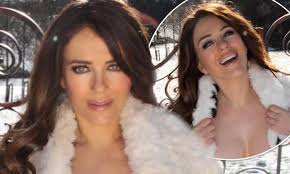 Get the best deals on mens hurley coat and save up to 70% off at poshmark now! Elizabeth Hurley Flooded With Requests To Help Fix Rusty Gate She Posed In Front Of In Topless Snaps Daily Mail Online