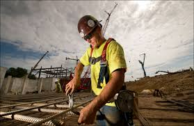 jh findorff son incs matt geske ties rebar for a footing mat aug 15 at the uw health at the american center project in madison rebar worker
