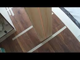 engineered hardwood floating floor installation in a long hallway how to tips mryoucandoityourself