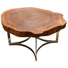 live edge table on modernist chrome base for