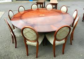 round extendable dining table seats 10 round dining table extendable expanding