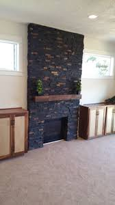 charcoal rust ledger stone accent wall and fireplace surround black ledger stone with rust tones
