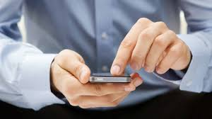 job search expenses how much to spend on travel attire man using a smart phone for a job search
