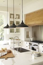 over stove lighting. white kitchen cabinets glass fronts stained range hoodblack hanging pendant lights over stove lighting