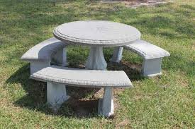century precast concrete table and benches in a public recreational park