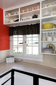 old simple white kitchen with brick