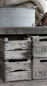 gray metal bucket and brown wooden crates