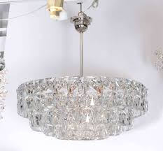 breathtaking chandelier comprised of 5 layers of deep cut faceted rectangular crystal prisms on a polished
