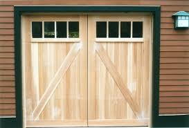 build a rustic door barn style garage doors designed by builder to match the