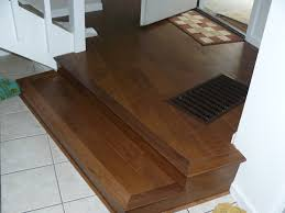 stunning brown teak patterns vinyl plank flooring in stairs areas combined with white ceramic floor tiled in modern interior house decors
