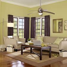 living room with a ceiling fan and floor lamp