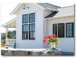 hardie board and batten siding. board and batten in the pitched portions here. hardie siding a