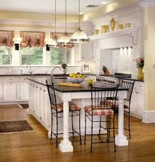 kitchen design cabinets traditional light: traditional kitchens white island also cabinetry with drawers and panel appliances recessed lighting black granite countertop