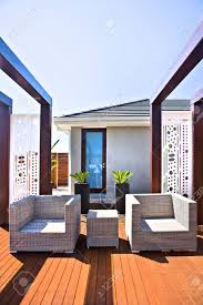 Modern patio floor Inexpensive Close Up Of Modern Patio Area In House With Chairs On The Wooden Floor Designtrends Close Up Of Modern Patio Area In House With Chairs On The