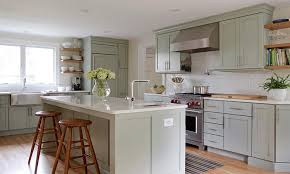 sage green kitchen features sage green cabinets paired with white quartz countertops and a white subway tiled backsplash