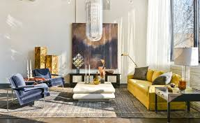 washed rug and yellow sofa