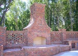 fence built in red brick outdoor fireplace