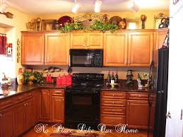 decorating above kitchen cabinets tuscany here s a closer look at the top of the cabinets everything you see