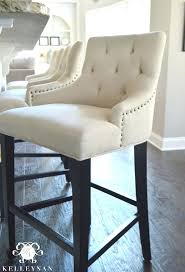 bar stools with nailhead trim world market linen bar stool tufted with trim brown leather counter