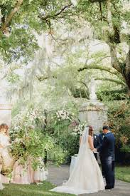 bride and groom exchange rings brookgreen gardens murrells inlet south ina