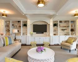 large family room plan with round wooden coffee table and best custom wall units