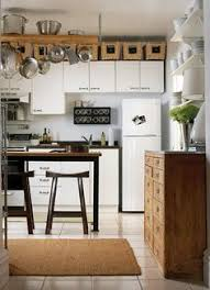 above kitchen cabinets ideas. Modren Kitchen Numbered Baskets Across The Top Of Upper Cabinets Provides Muchneeded  Storage Warmth And Texture To Basic White Kitchen While A Hanging Pot Rack  And Above Kitchen Cabinets Ideas I