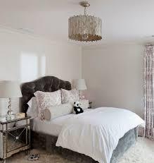 chic pink and gray girl s bedroom with worlds away faceted chandelier over dark gray velvet tufted headboard with gray velvet bed skirt pink shams