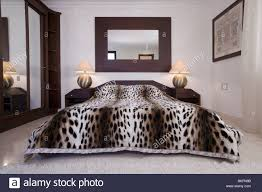 Modern Mirrors For Bedroom Large Mirror Above Bed With Faux Leopardskin Bed Cover In Modern