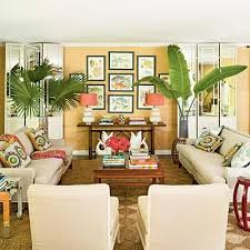 a mix of retro furniture vintage decorations and tropical accents give this room its beach house living room tropical family room