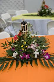 Hawaiian Theme Wedding Reception | Hawaiian themed wedding reception.  Centerpieces and mini tiki torches .